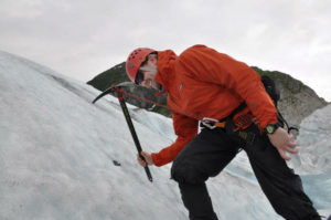 Scott Osmun climbing with snow pick