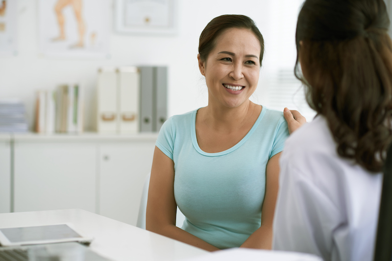 Middle-aged woman sees doctor about menopause